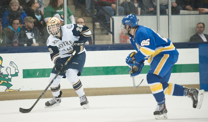 Steven Fogarty pushes the puck ahead against Lake Superior State on Saturday, a 4-2 Irish win. Fogarty scored two goals in the game.