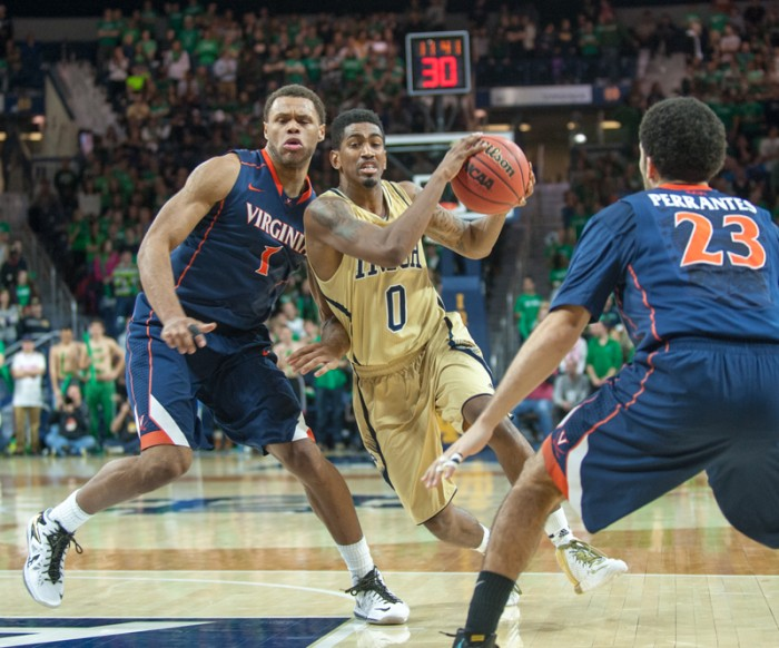 Irish senior guard Eric Atkins drives into the lane during Notre Dame's 68-53 loss to Virginia on Tuesday. Atkins scored six points, and the two leaders on the night for the Irish netted 10 each.