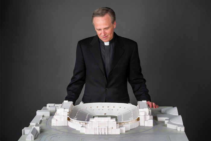 Fr. John Jenkins surveys a model for the Stadium expansion that was presented to the Board of Trustees for approval on Jan. 29.