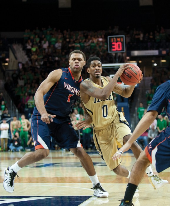 Senior guard Eric Atkins drives during Notre Dame's 68-53 loss to Virginia on Jan. 28. Atkins leads the Irish in total assists this season.