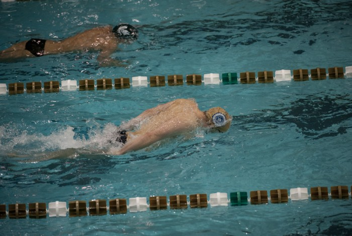 John Williamson swims in the 200-meter fly during a dual meet against Michigan State on Nov. 15.
