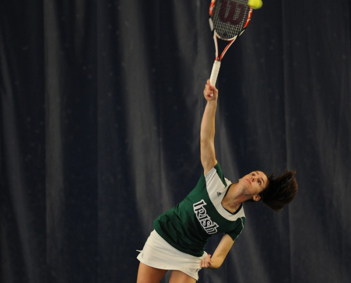 Irish senior Jennifer Kellner serves during a home meet last season. Kellner is a two-time all-Big East honoree.
