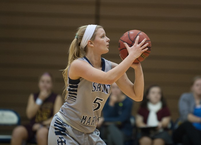 Belles freshman guard Timoney Moyer lines up a shot during Saint Mary's 95-68 loss to Calvin on Jan. 15.