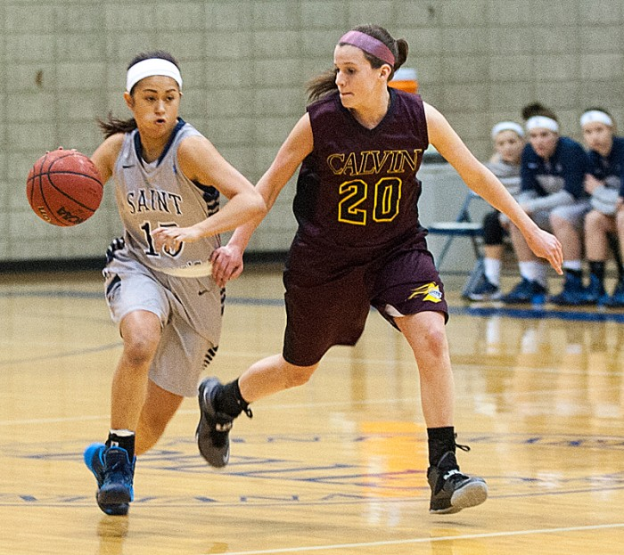 Saint Mary's freshman guard Heather Pesigan drives the ball up the court during the Belles'  95-68 loss to Calvin on Jan. 15. Saint Mary's fell 71-66 to Kalamazoo on Saturday.