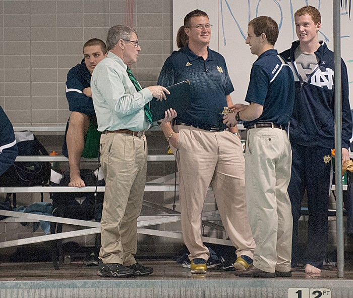Irish coach Tim Welsh, far left, talks over his team's win Saturday against Cleveland State, which was his last home meet as head coach.