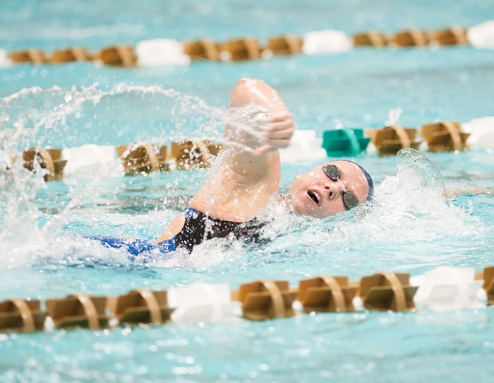 Junior Emma Reaney swims the freestyle segment of the 200-yard individual medley at the Shamrock Invitational against Iowa on Friday. Reaney broke a Rolfs Aquatic Center record in that swim.