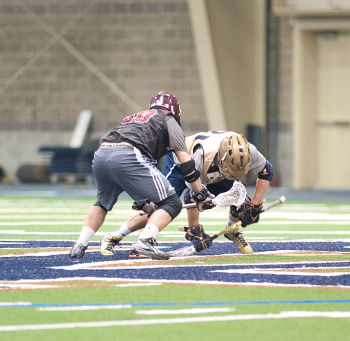 Irish junior midfielder and face-off specialist Liam O'Connor goes for the groundball during Notre Dame's scrimmage against Bellamarine on Feb. 1.
