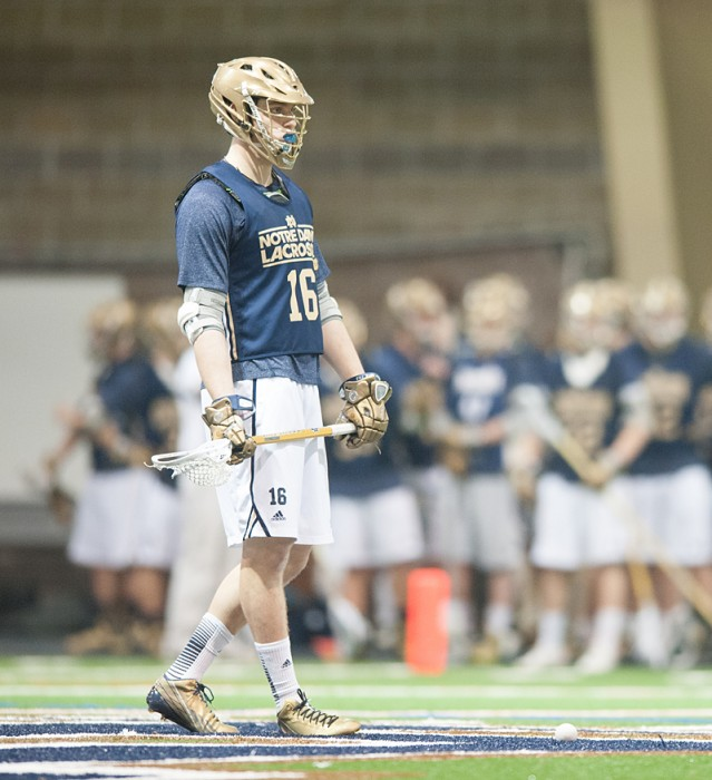 Freshman midfielder Sergio Perkovic watches game action against Detroit on Sunday at the Loftus Center. Perkovic scored three goals against Bellarmine in a contest the day before, a 12-5 Notre Dame win.