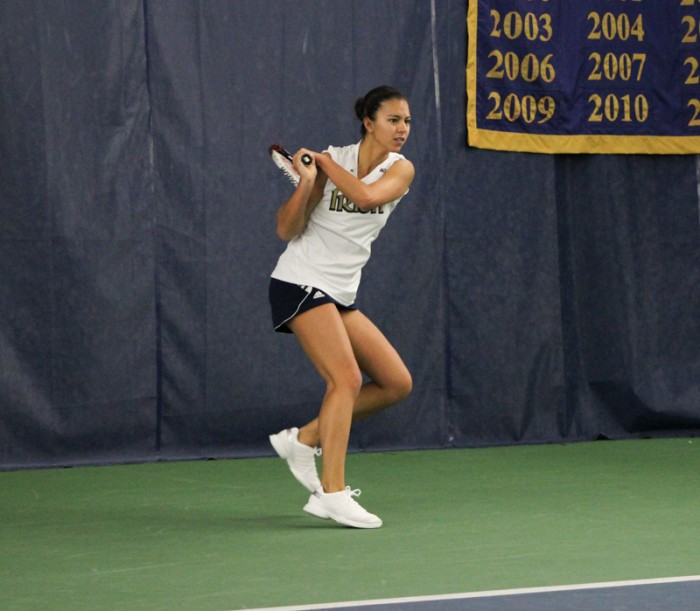 Senior Britney Sanders follows through her backhand in a match against Indiana on Sunday. The Irish defeated the Hoosiers 4-3.