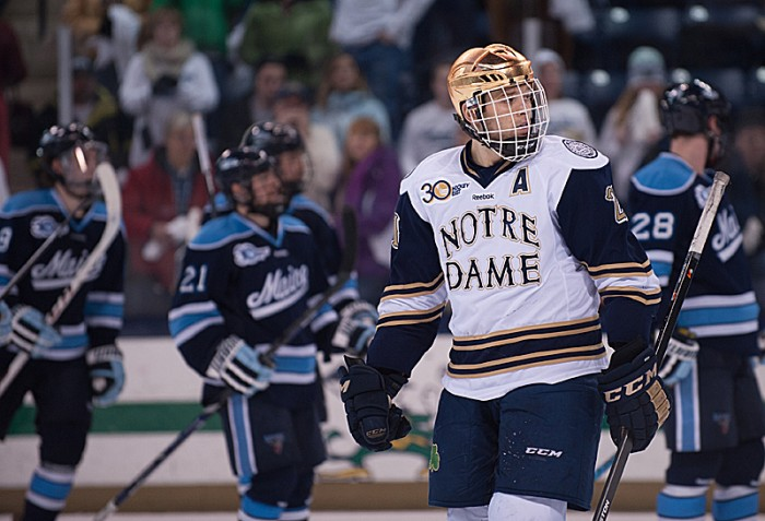 Senior right wing Bryan Rust takes a break during Notre Dame's 2-1 loss to Maine on Friday. Rust scored two goals the next night.