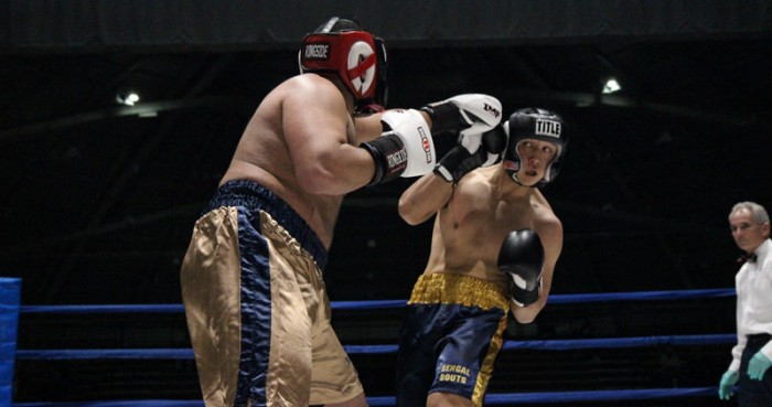 Senior captain and club president Daniel Yi, right, dodges a punch from law student Brian Israel during his victory by unanimous decision in the semifinals on Tuesday. Yi has won three straight Bengal Bouts titles and will go for a historic fourth on Sunday against freshman Erich Jegier.