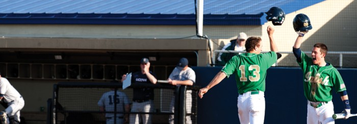 Irish junior Mac Hudgins (13) celebrates with a teammate during Notre Dame's 12-2 victory over Connecticut on April 26 last season. Hudgins started 31 games for the Irish last season and had 29 doubles.