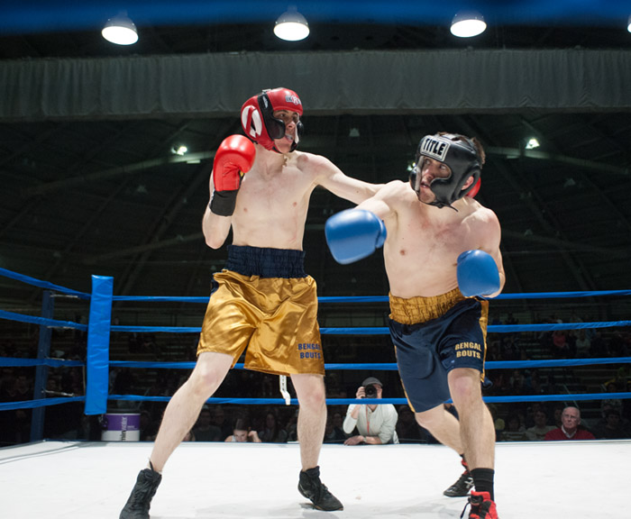Senior captain Ben Eichler, right, dodges a big swing from sophomore Ryan Dunn during their semifinal bout Tuesday night. Eichler emerged victorious by a split decision.