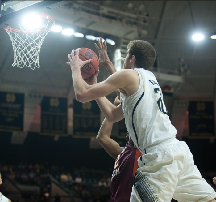 Irish sophomore forward Austin Burgett goes up for a shot during Notre Dame's 70-63 win over Virginia Tech on Jan. 19.