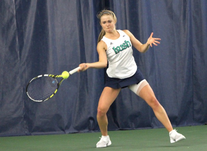 Notre Dame freshman Monica Robinson returns a serve against Indiana on Saturday. Robinson lost in a tie breaker to Indiana senior Sophie Garre, 4-6, 6-3, (10-6).