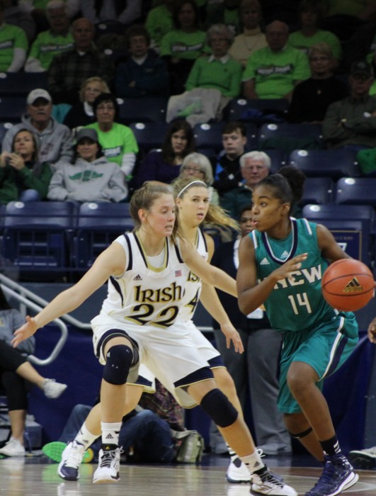 Irish junior guard Madison Cable defends the ballhandler during Notre Dame's 99-50 victory over UNC Wilmington on Nov. 9, 2013.