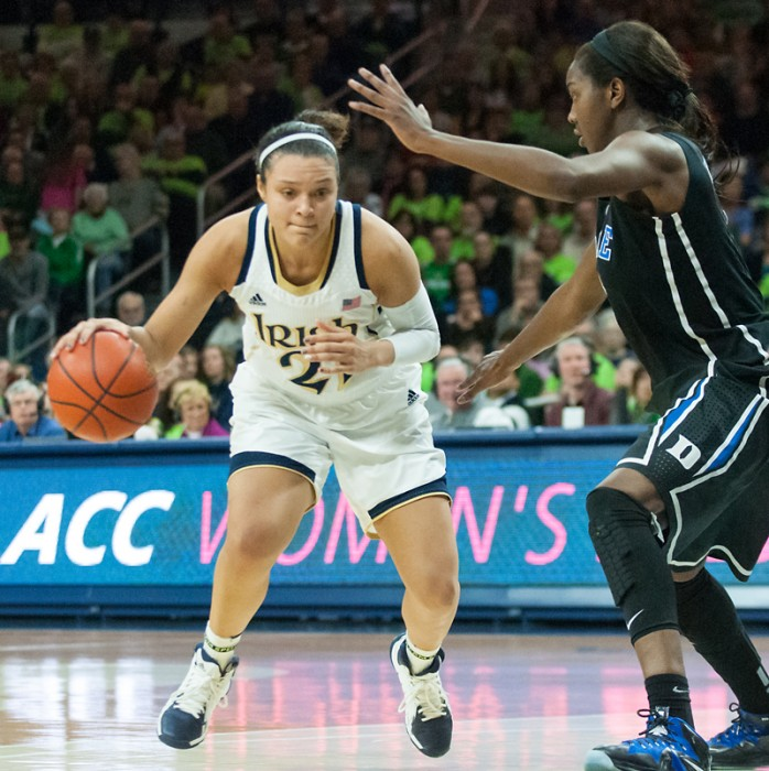 Irish senior guard Kayla McBride drives to the hoop against Duke on  Sunday. McBride had a career-high 31 points in the 81-70 Irish win.