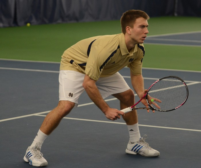 Senior Matt Dooley competes in a match against Marquette in Eck Tennis Pavilion on Jan. 19, 2013.
