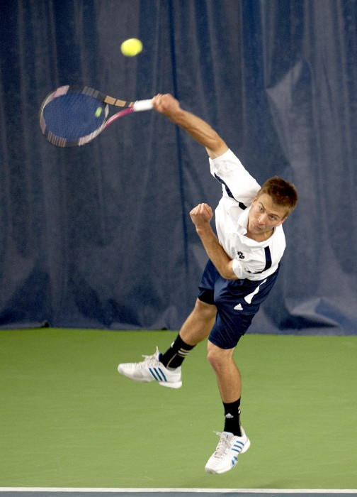 Senior Matt Dooley fires a serve against SMU on April 4. Dooley wrote about his life as a gay athlete at Notre Dame in a recent article.