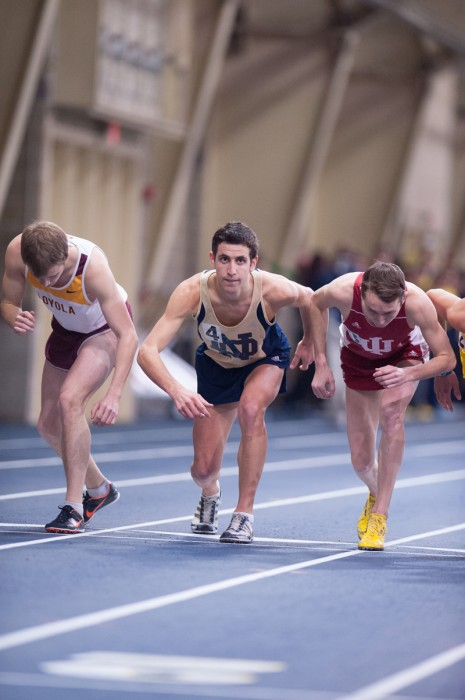 ZACH LLORENS | The Observer Fifth-year student Jeremy Rae takes his mark at the Meyo  Invitational on Feb. 8.  Rae won the Meyo Mile for the Irish.