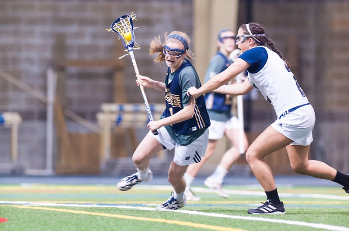 Sophomore attack Kiera McMullan tries to power past a Michigan defender during Notre Dame's 19-7 exhibition victory over the Wolverines on Feb. 8 at the Loftus Sports Center.