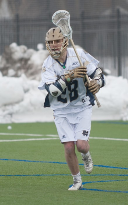 Irish junior attack Conor Doyle chases a loose ball during the game against Penn State on Feb. 22 at Arlotta Stadium. Doyle scored a career-high and team-leading four goals during Saturday's 11-10 loss to Syracuse.