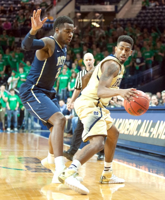 Irish senior guard Eric Atkins controls the ball during Notre Dame's 85-81 overtime loss to Pittsburgh on Saturday in Purcell Pavilion.