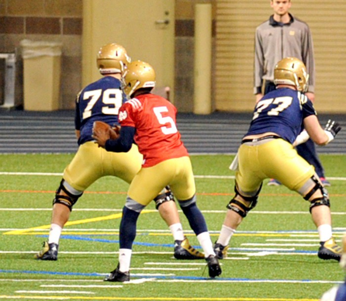 Senior quarterback Everett Golson (5) looks to hand the ball off at Notre Dame's first spring practice Monday at Loftus Sports Center.