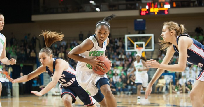 Freshman guard Lindsay Allen drives to the hoop Saturday in the 93-42 Irish win over Robert Morris.