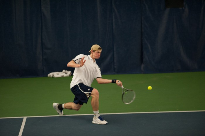 Irish junior Wyatt McCoy prepares to connect with a shot during Notre Dame's 4-3 win over Virginia Tech on Feb. 28.