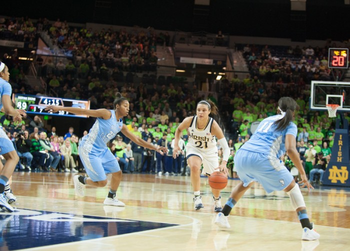 Irish junior guard Whitney Holloway races down the court during Notre Dame's 100-75 victory over North Carolina on Feb. 27. The Irish begin competition in the NCAA tournament against Robert Morris on Saturday.