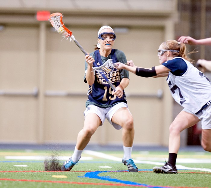 Irish senior midfield Julia Giorgia dodges a Michigan player during Notre Dame's 19-7 victory over the Wolverines on Feb. 8. The Irish, coming off of two straight losses, will take on Duke on Friday at Arlotta Stadium at 7 p.m.