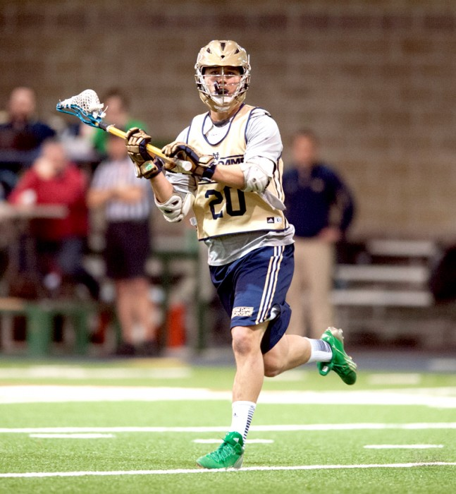 Irish junior midfield Nick Ossello looks for an open teammate during an exhibition game against Bellarmine on Feb. 2.