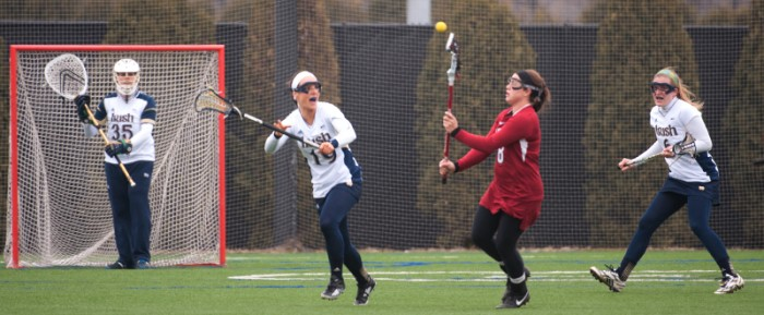 Irish senior midfielder Julia Giorgio attempts to slow the Stanford offense during Notre Dame's 11-10 loss March 29.