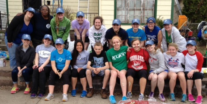 A group of Saint Mary's Rebuilding Together volunteers poses in front of a local home they helped repair Saturday.
