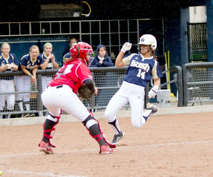 Irish senior outfielder Monica Torres prepares to collide with the catcher at home plate durng an exhibition against Illinois State on Sept. 5, 2013.