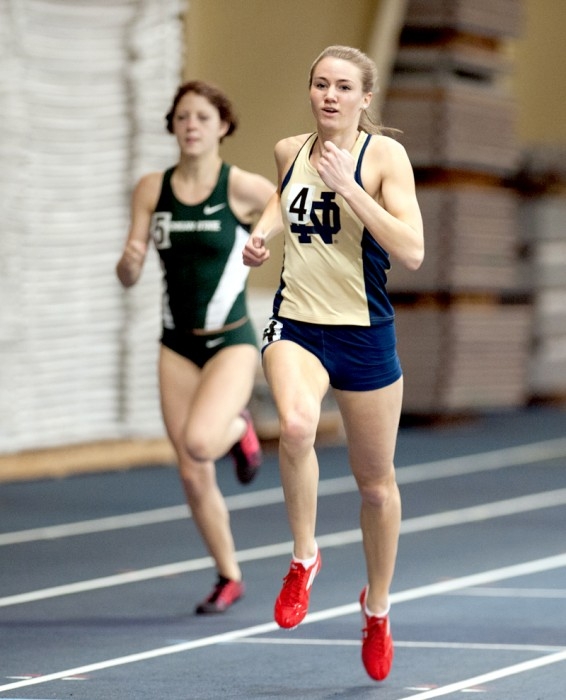 Irish sprinter senior Megan Yanik crosses the finish line during the Notre Dame Invitational on Jan. 25.