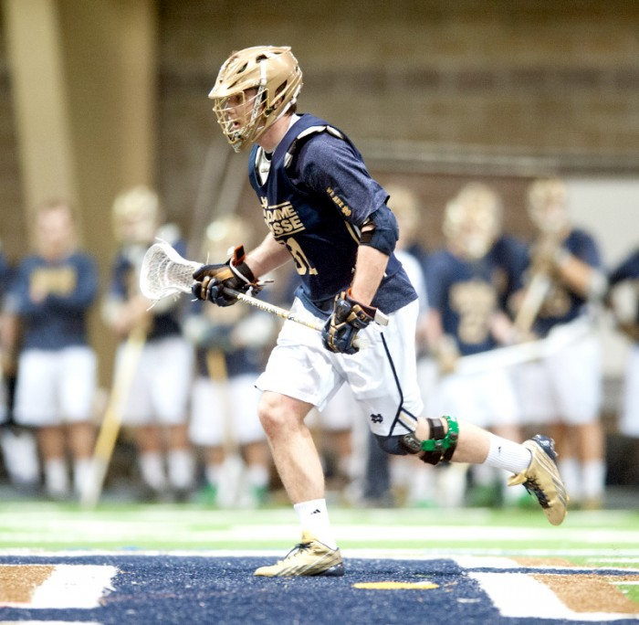 Irish senior midfield Liam O'Connor runs downfield in a  scrimmage with Detroit on Feb. 2 at Loftus Sports Center.