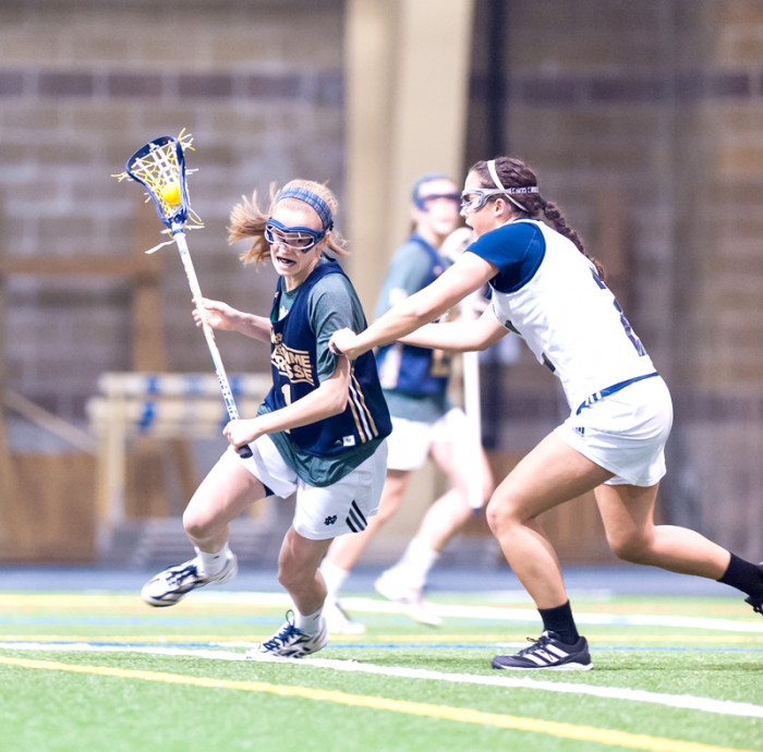 Irish sophomore attack Kiera McMullan cuts around a defender during Notre Dame's 19-7 win over Michigan on Feb. 8.