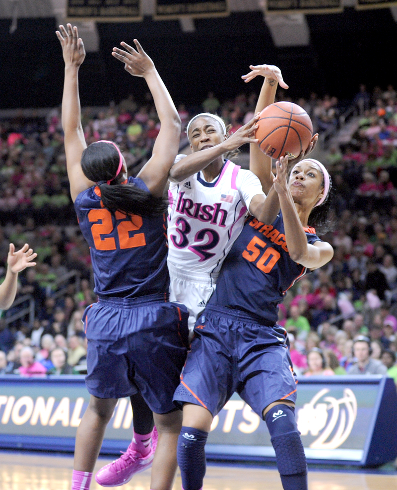 Irish sophomore guard Jewell Loyd tries to split two defenders during Notre Dame's 101-64 victory over the Orange on Feb. 9. Loyd leads all Irish scorers with 18.8 points per game.
