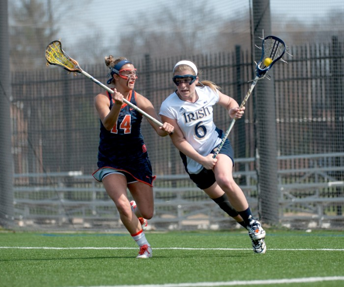 Sophomore attack Stephanie Toy tries to evade Syracuse senior      defender Kasey Mock in the teams' first meeting of the year April 19.
