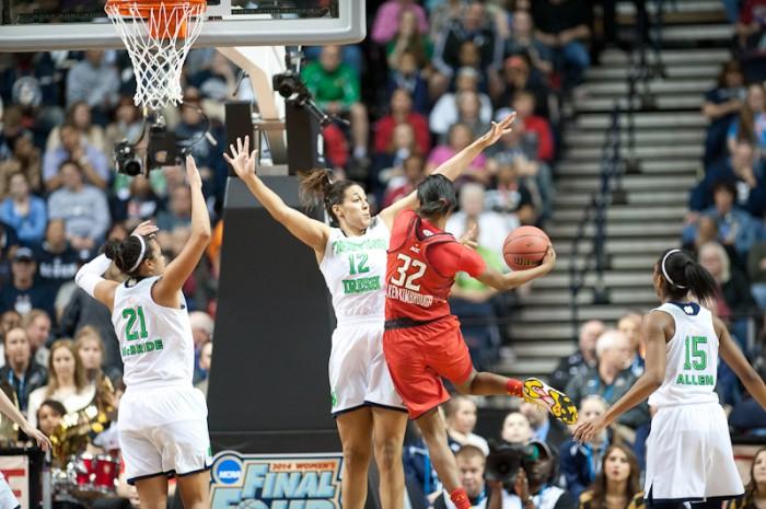 Freshman forward Taya Reimer defends a shot from Maryland freshman guard Shatori Walker-Kimbrough in the national semifinal Sunday.