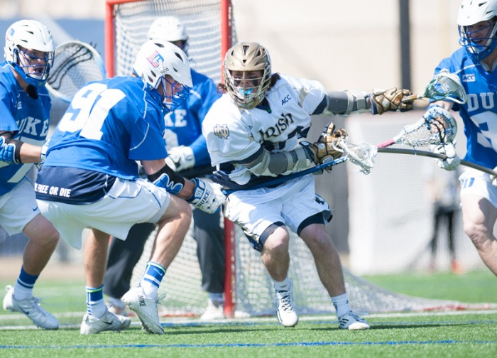 Sophomore attackman Matt Kavanagh tries to sneak past a defender during Notre Dame's 15-7 loss to the Blue Devils on April 5.