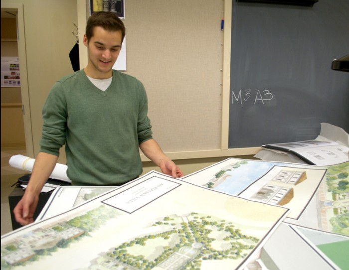 Fifth-year architecture student Mark Santrach reviews reprints of watercolors he created for class projects while studying abroad in Rome. Santrach earned a 3.993 cumulative grade point average at Notre Dame.