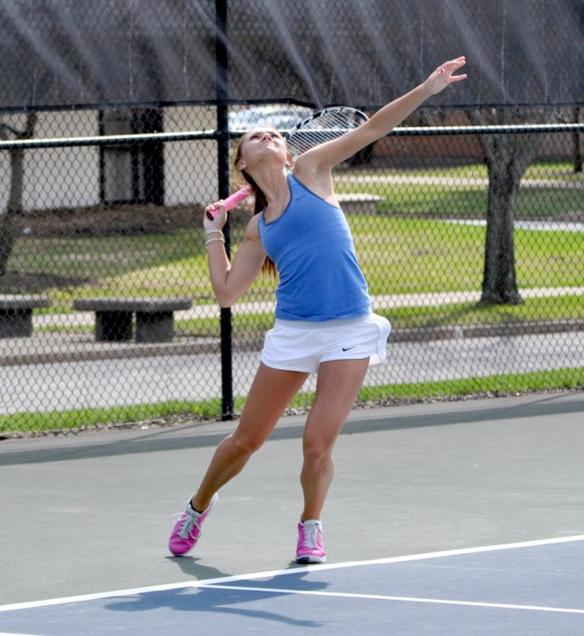 Saint Mary's junior Kayle Sexton unleashes a serve during the Belles' 8-1 loss to Hope on April 17.