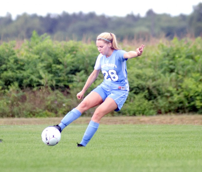 Belles sophomore midfielder Kathryn Lueking connects with the ball during Saint Mary's 4-1 victory against Illinois Tech on Sept. 2. Lueking started all 20 games for the Belles in 2013.