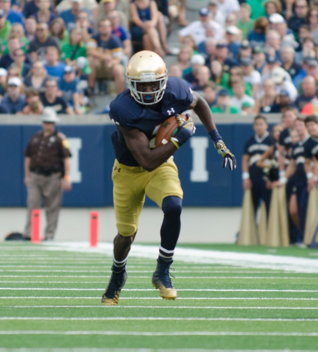 Junior receiver Chris Brown dashes down the field after making a catch during Notre Dame's 48-17 win over Rice on Saturday.