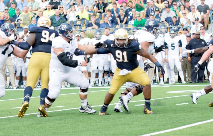 Irish senior defensive end and captain Sheldon Day works past his blocker in an attempt to get to the ball carrier during Notre Dame's 48-17 victory over Rice.