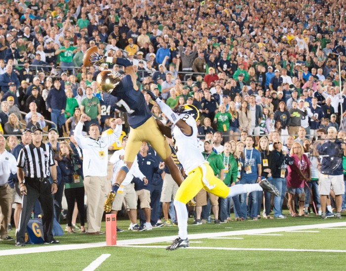 Former Irish receiver Will Fuller leaps to haul in a touchdown pass from former quarterback Everett Golson during Notre Dame's 31-0 win over Michigan on Sept. 6, 2014 at Notre Dame Stadium.
