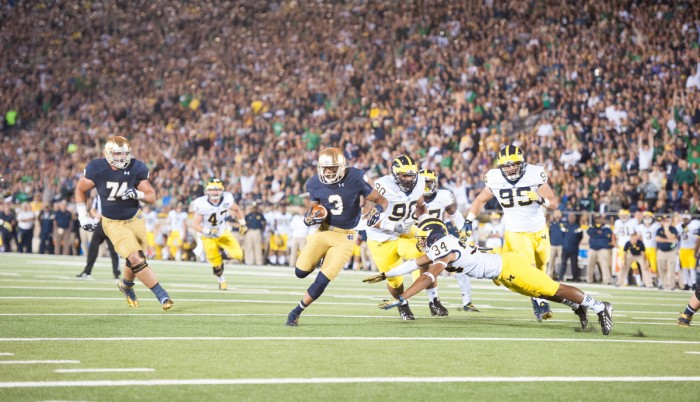 Irish senior receiver Amir Carlisle eludes a Michigan defender during Notre Dame's 31-0 victory over Michigan on Saturday.